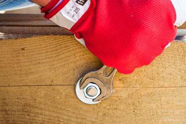 repair man wrenching a bolt