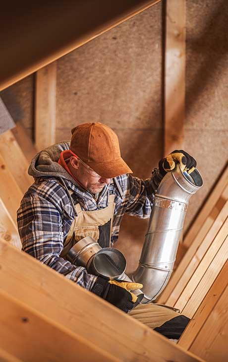 technician Building a Ventilation System