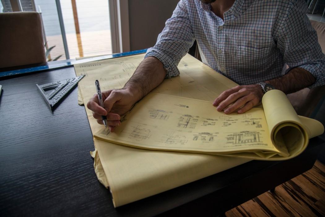 designer working on blueprints