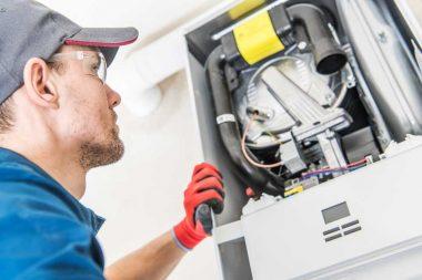 repair man working on a air heater unit
